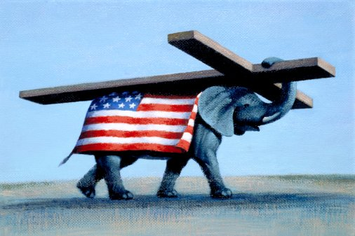View of an elephant wearing an American flag carrying a cross